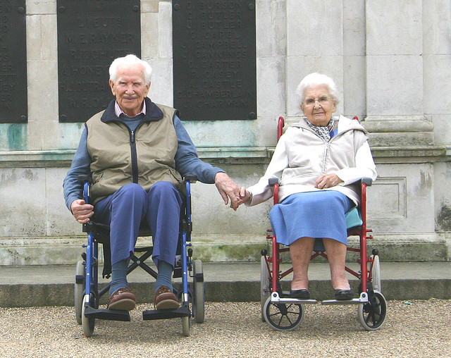 old-couple-in-wheel-chair.jpg